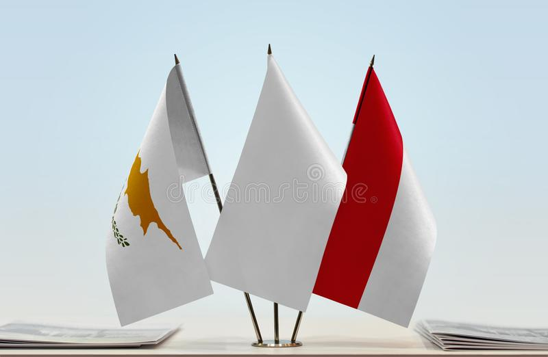 Flags of Cyprus and Monaco. Desktop flags of Cyprus and Monaco and white flag in the middle royalty free illustration