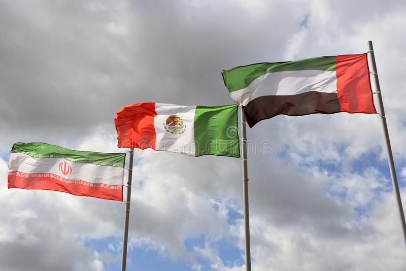 Flags of different counties, United Arab Emirates and others, blue sky background. Color photo, no people stock photos