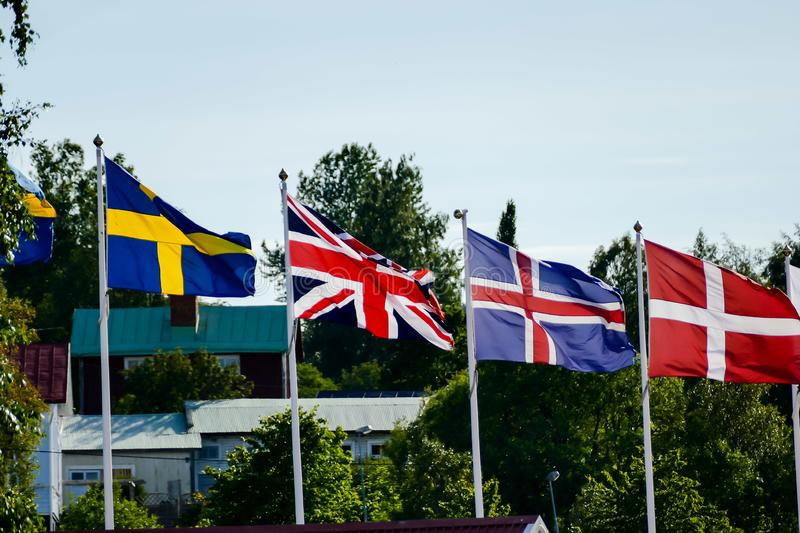 flags of different countries on a background of blue sky, in Sweden Scandinavia North Europe royalty free stock photography
