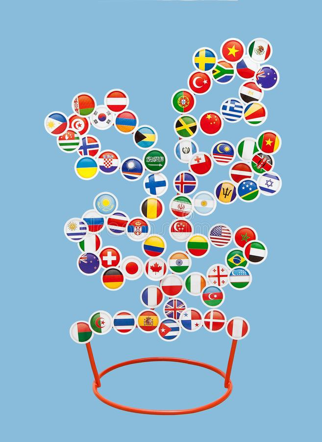 Flags of different countries of the World in the form of stickers on a metal rack in the form of a tree stock illustration