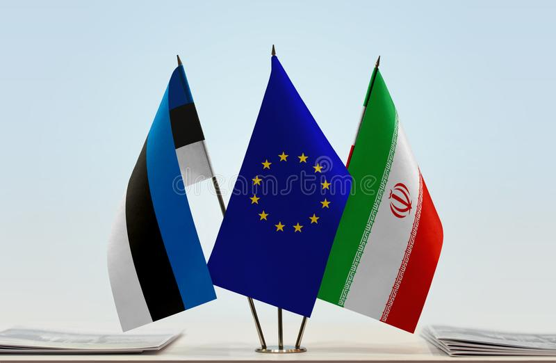 Flags of Estonia EU and Iran. Desktop flags of Estonia and Iran with European Union flag in the middle stock images