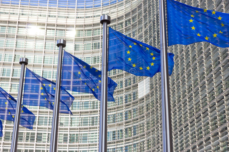Flags EU Commission building. Flags in front of the EU Commission building in Brussels royalty free stock photos