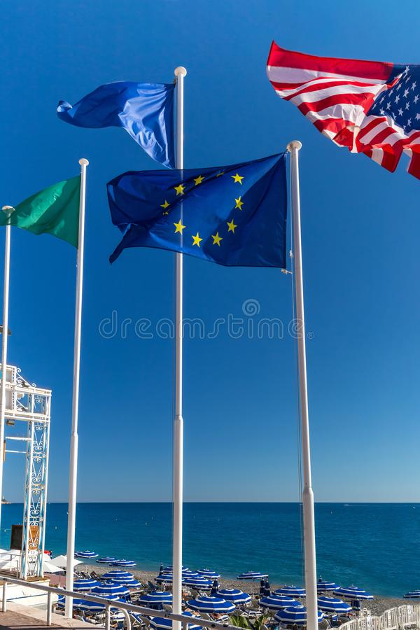 Flags of the EU and the US. European and American flags on the background of the sky and the sea stock photo
