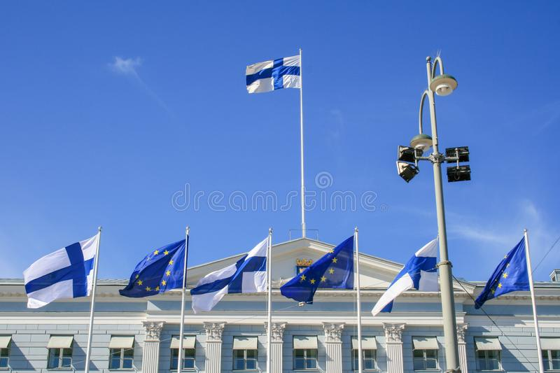 Flags of Europe and Finland waving together on the Presidential Palace in Helsinki royalty free stock images