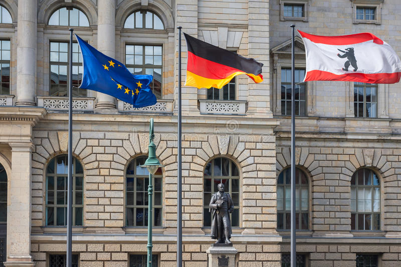 3 flags (Europe, Germany, Berlin). Infront of Abgeordnetenhaus of Berlin, the state parliament (Landtag) for the German state of Berlin, Germany royalty free stock photography