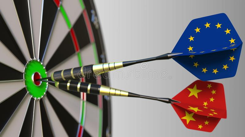 Flags of the European Union and China on darts hitting bullseye of the target. International cooperation or competition. Flags of the European Union and China on royalty free stock images