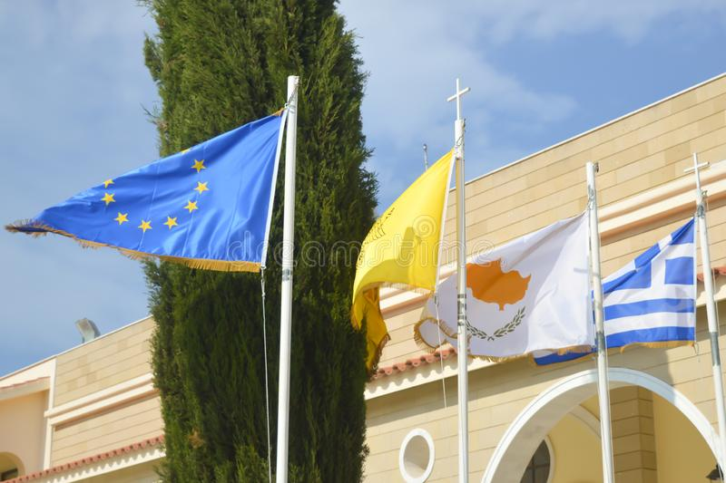Flags of European Union, Cyprus and Greece on sunny day, Cyprus on June 12, 2018. PROTARAS, CYPRUS - JUNE 12: Flags of European Union, Cyprus and Greece on royalty free stock photos