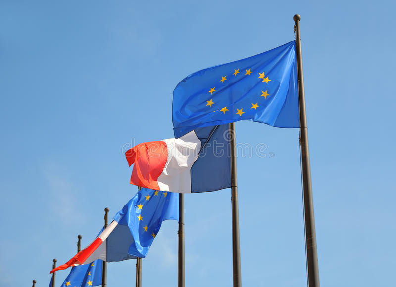 Flags of the European Union and France. In clear windy day stock photo
