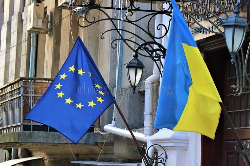 Flags of the European Union and of the Ukraine, hanging on a public building. Ukrainian people manifest because they want to become part of the European Union royalty free stock photos