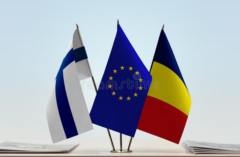Flags of Finland EU and Chad. Desktop flags of Finland and Chad with European Union flag in the middle stock images