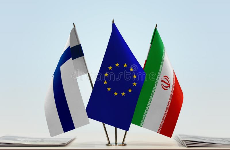 Flags of Finland EU and Iran. Desktop flags of Finland and Iran with European Union flag in the middle stock photography