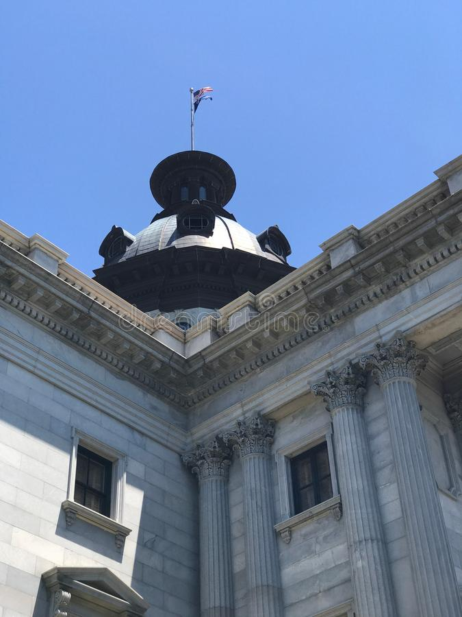 Flags Fly High on top of the South Carolina State House stock photo