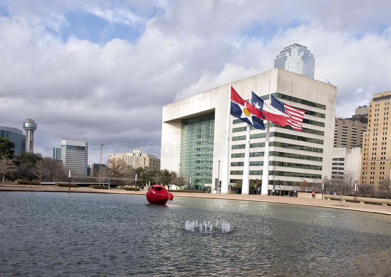 Flags flying in front of Dallas City Hall, seat of municipal government. Pictured are the City of Dallas, Texas, and American Flags flying in front of Dallas stock photography