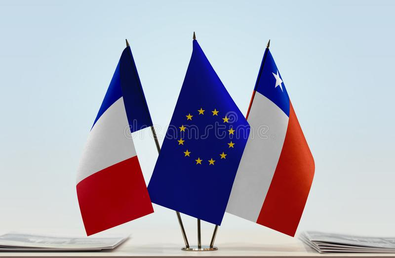 Flags of France EU and Chile. Desktop flags of France and Chile with European Union flag in the middle royalty free stock images