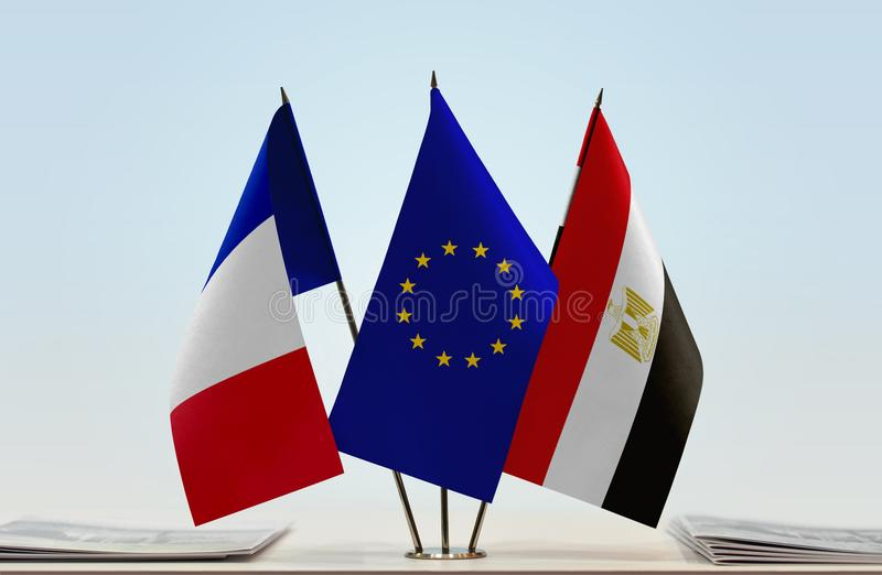 Flags of France EU and Egypt. Desktop flags of France and Egypt with European Union flag in the middle stock photos