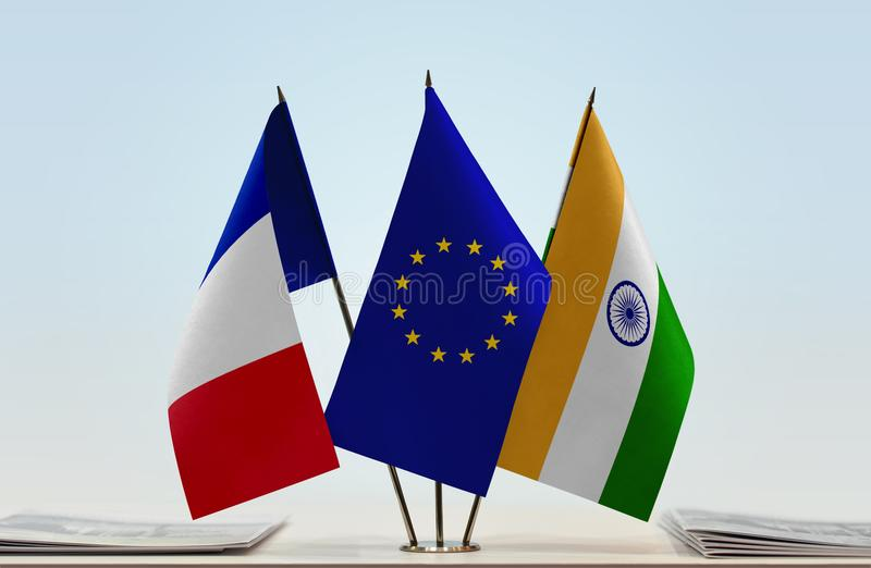 Flags of France EU and India. Desktop flags of France and India with European Union flag in the middle stock images