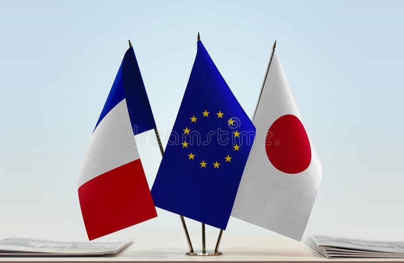 Flags of France EU and Japan. Desktop flags of France and Japan with European Union flag in the middle royalty free stock photos