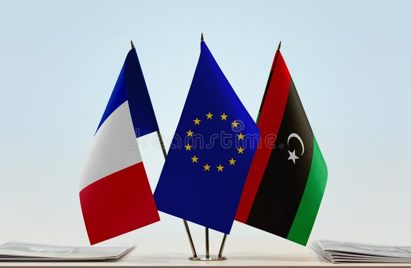 Flags of France EU and Libya. Desktop flags of France and Libya with European Union flag in the middle stock image