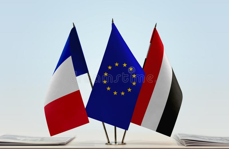 Flags of France EU and Yemen. Desktop flags of France and Yemen with European Union flag in the middle stock photo