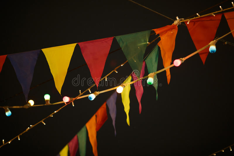 Flags with garlands in night. Sky in celebration royalty free stock images