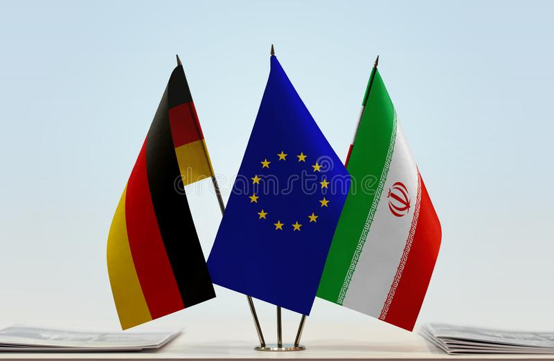 Flags of Germany EU and Iran. Desktop flags of Germany and Iran with European Union flag in the middle royalty free stock photos