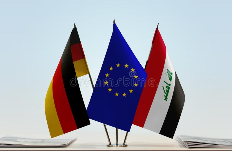 Flags of Germany EU and Iraq. Desktop flags of Germany and Iraq with European Union flag in the middle royalty free stock image