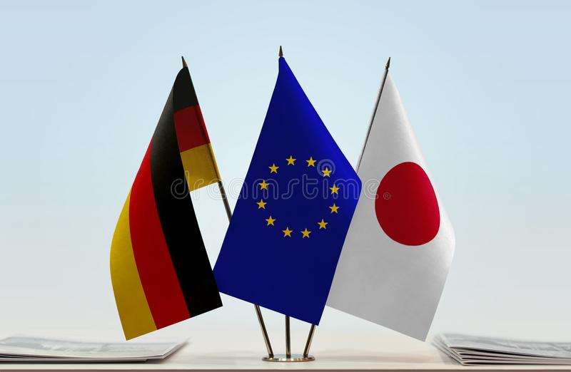 Flags of Germany EU and Japan. Desktop flags of Germany and Japan with European Union flag in the middle stock photos