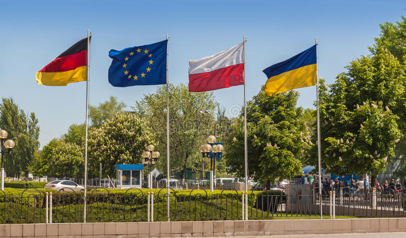 Flags of Germany, the European Union, Poland and Ukraine. In Kiev's street spring stock images
