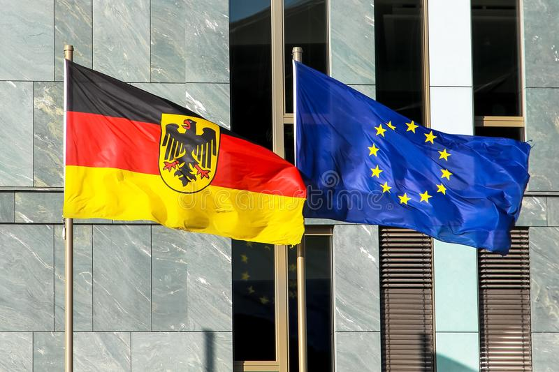 Germany Flag and EU Flag: Germany Federal Republic of Germany; in German: Bundesrepublik Deutschland and the European Union EU. Flags of Germany Federal Republic royalty free stock image
