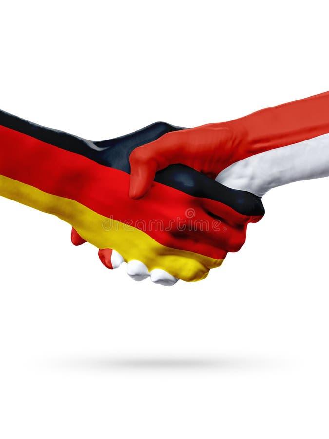 Flags Germany, Monaco countries, partnership friendship handshake concept. royalty free stock photo