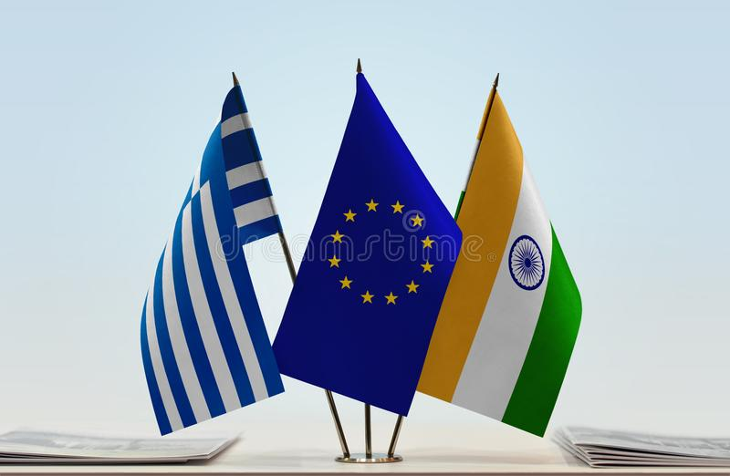 Flags of Greece EU and India. Desktop flags of Greece and India with European Union flag in the middle stock photography
