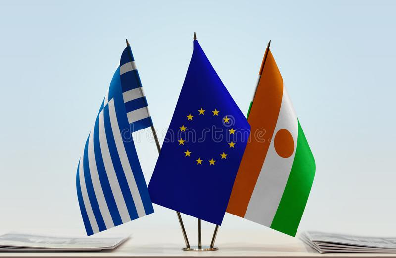 Flags of Greece EU and Niger. Desktop flags of Greece and Niger with European Union flag in the middle stock photography