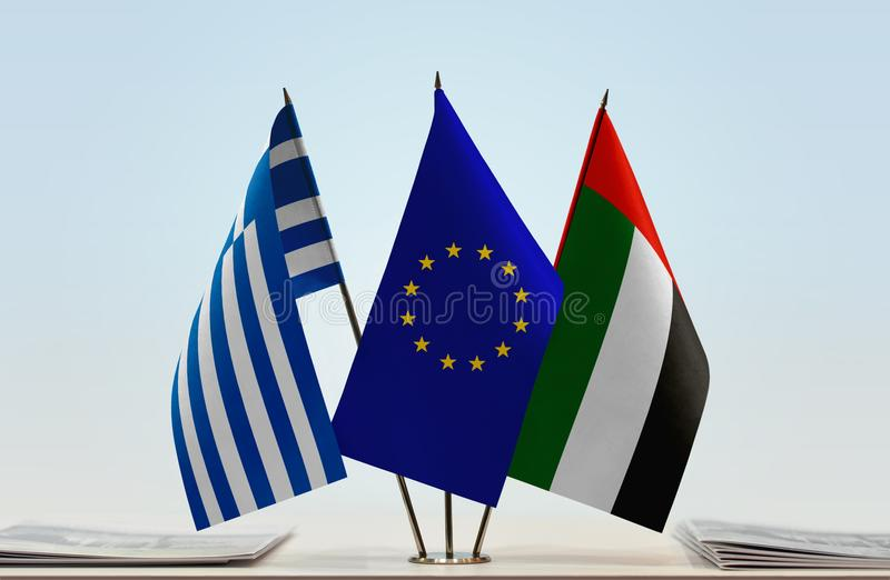 Flags of Greece EU and UAE. Desktop flags of Greece and UAE with European Union flag in the middle royalty free stock photography