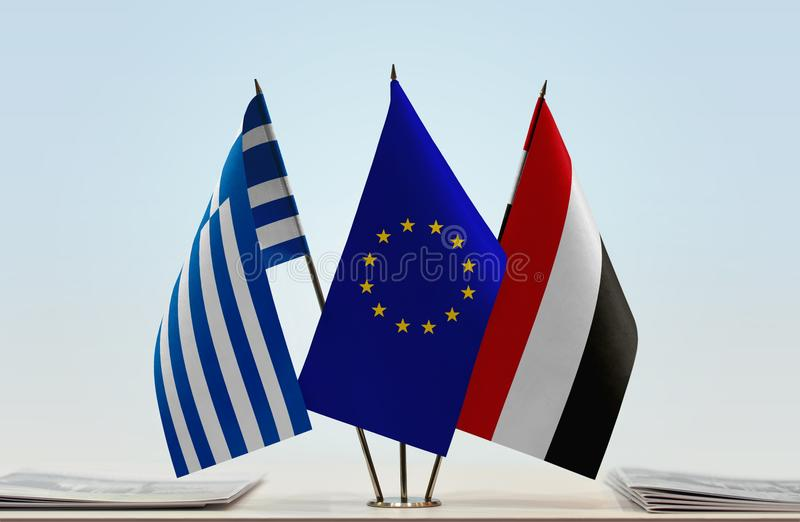 Flags of Greece EU and Yemen. Desktop flags of Greece and Yemen with European Union flag in the middle stock photo