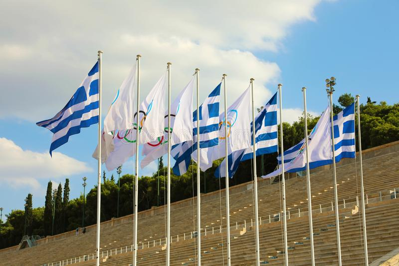 Flags of Greece and flags of Olympic games wave outside of Panathenaic Stadium in Athens, Greece on July 18, 2018 royalty free stock photos