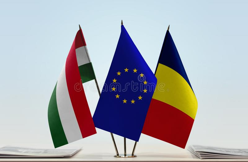 Flags of Hungary EU and Chad. Desktop flags of Hungary and Chad with European Union flag in the middle stock photography