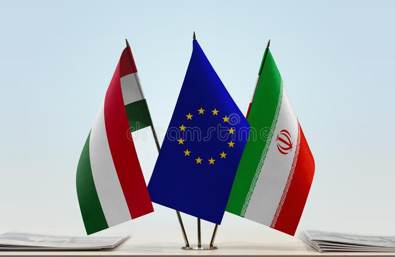 Flags of Hungary EU and Iran. Desktop flags of Hungary and Iran with European Union flag in the middle stock photo