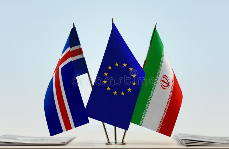 Flags of Iceland EU and Iran. Desktop flags of Iceland and Iran with European Union flag in the middle stock image