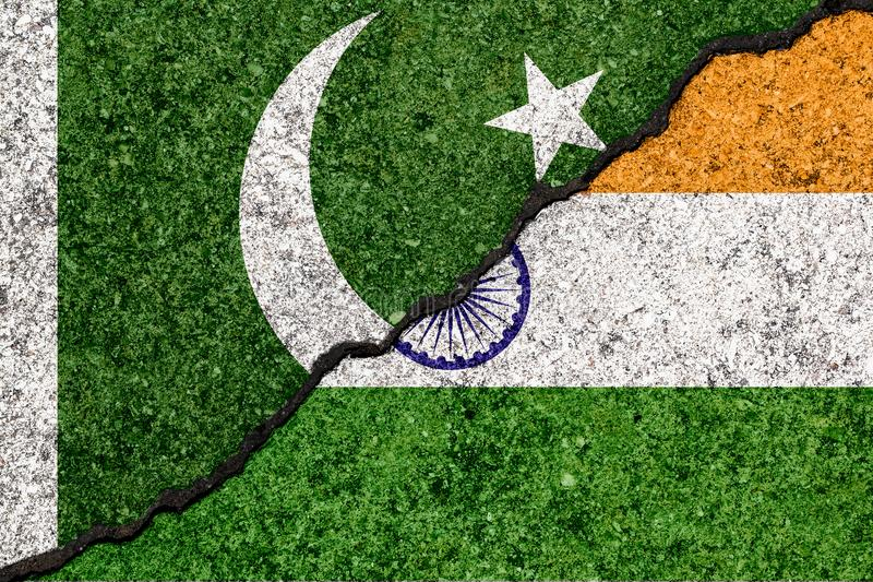 Flags of India and Pakistan painted on cracked wall background/ stock illustration