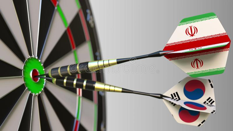 Flags of Iran and Korea on darts hitting bullseye of the target. International cooperation or competition conceptual 3D. Flags of Iran and Korea on darts hitting stock images