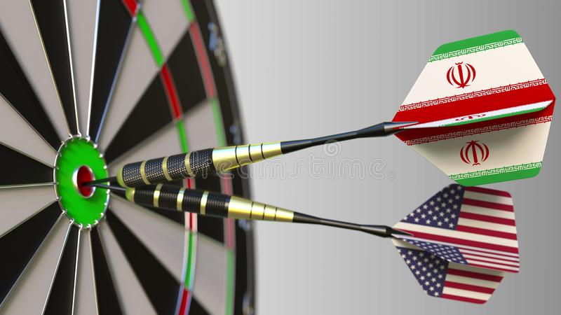 Flags of Iran and the USA on darts hitting bullseye of the target. International cooperation or competition conceptual. Flags of Iran and the USA on darts stock image