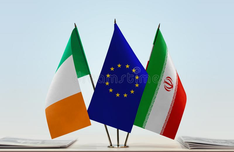Flags of Ireland EU and Iran. Desktop flags of Ireland and Iran with European Union flag in the middle royalty free stock photo