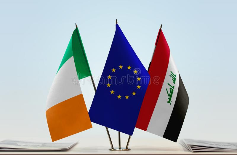 Flags of Ireland EU and Iraq. Desktop flags of Ireland and Iraq with European Union flag in the middle stock photography
