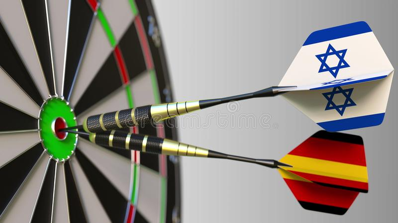 Flags of Israel and Germany on darts hitting bullseye of the target. International cooperation or competition conceptual. Flags of Israel and Germany on darts royalty free stock photo