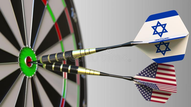 Flags of Israel and the USA on darts hitting bullseye of the target. International cooperation or competition conceptual. Flags of Israel and the USA on darts stock photo
