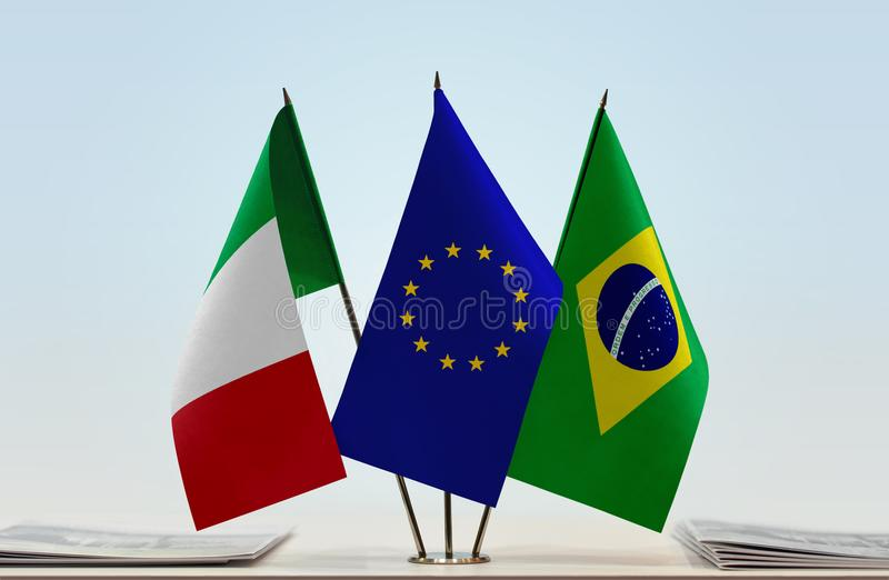 Flags of Italy EU and Brazil. Desktop flags of Italy and Brazil with European Union flag in the middle stock images