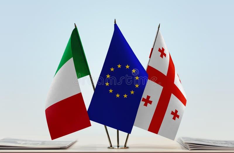 Flags of Italy European Union and Georgia. Desktop flags of Italy European Union and Georgia royalty free stock photo