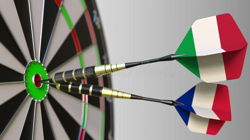 Flags of Italy and France on darts hitting bullseye of the target. International cooperation or competition conceptual. Flags of Italy and France on darts stock photo