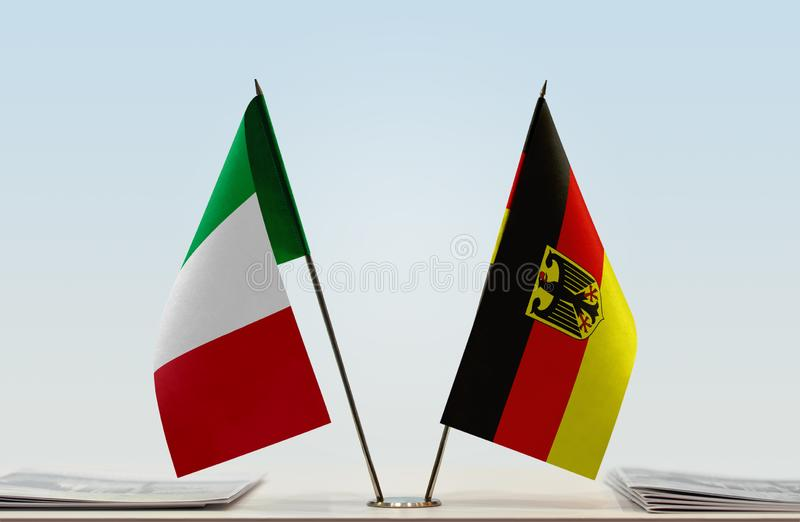 Flags of Italy and Germany. Two table flags of Italy and Germany royalty free stock photo