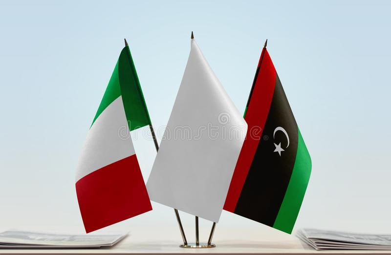 Flags of Italy and Libya. Desktop flags of Italy and Libya with white flag in the middle vector illustration